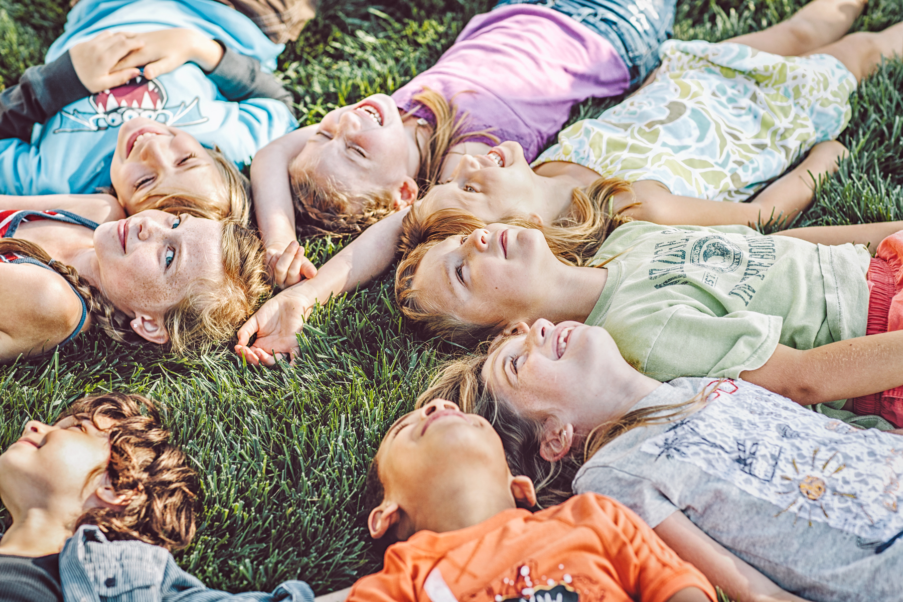 Children Lying in the Grass with their Heads in a Circle