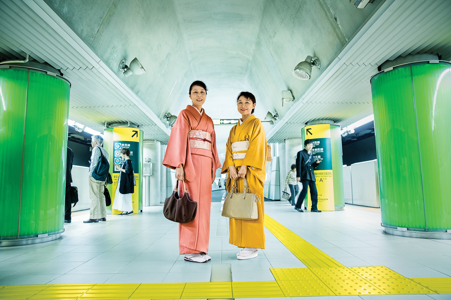 Two Women in Kimonos in the Subway