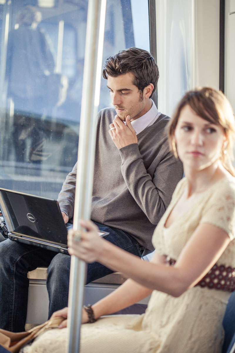 Lifestyle Advertising Man working on Laptop During Commute