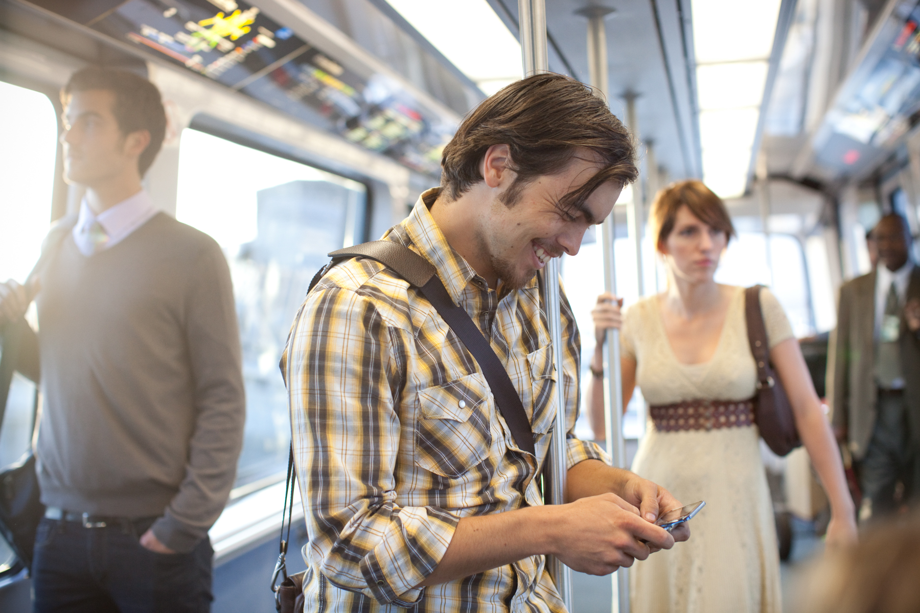Lifestyle Advertising Man Texting on Phone During Commute
