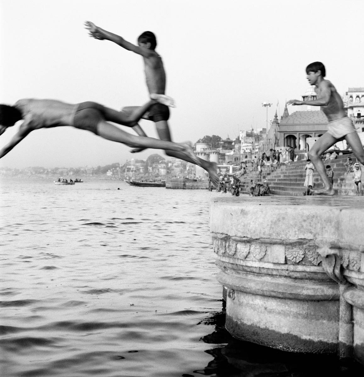 Boys Jumping into the Ocean