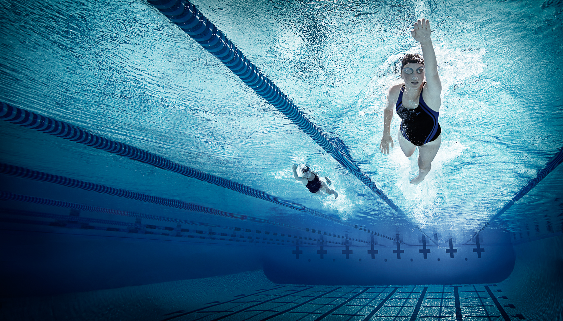Underwater Shot of Two Swimmers in a Pool